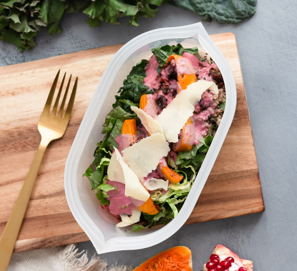 Reusable silicone dish overhead with salad in it
