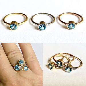 Blue topaz rings make the summer turns blue