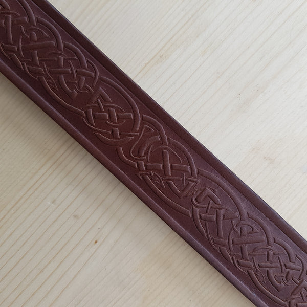 Close up of brown narrow belt pattern