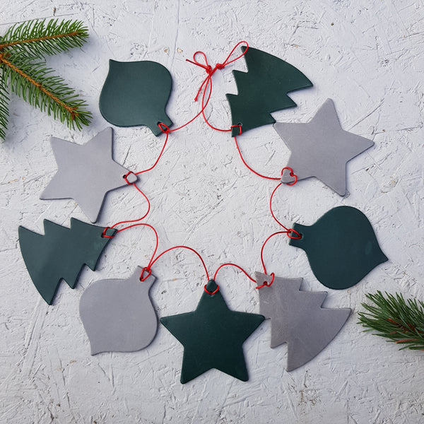 green and silver grey christmas leather bunting with tree star and bauble shapes