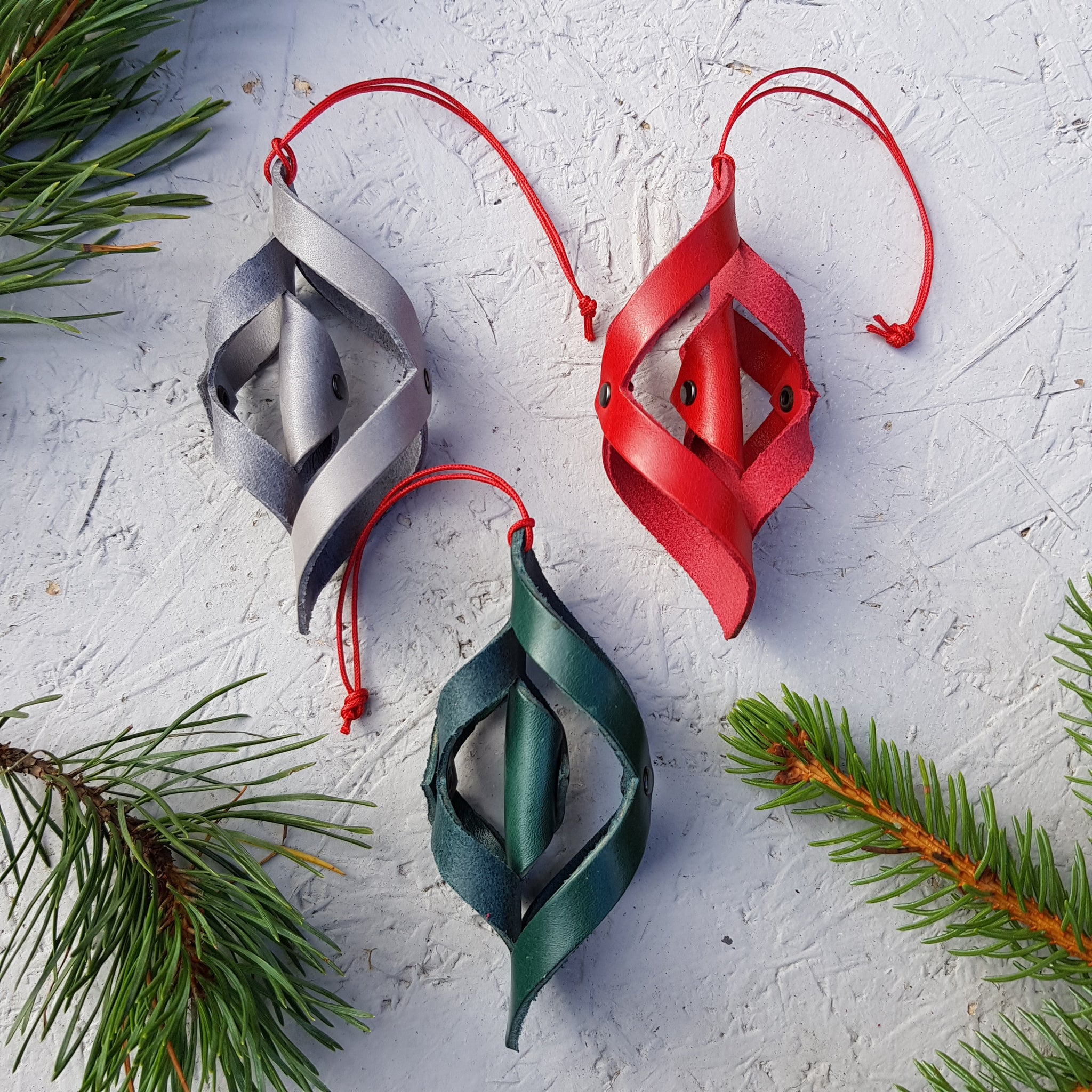 Three twisted leather handmade decorations