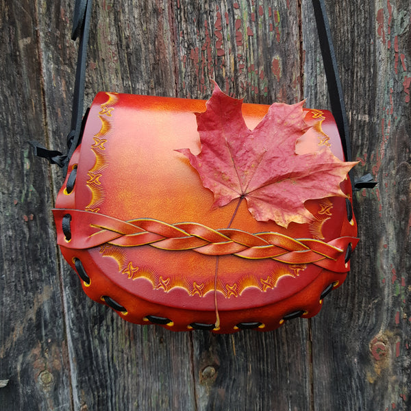 Autumn inspired tan leather handbag with leaf
