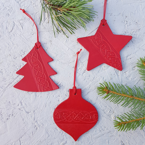 Set of three red leather christmas tree decorations with a celtic knot design
