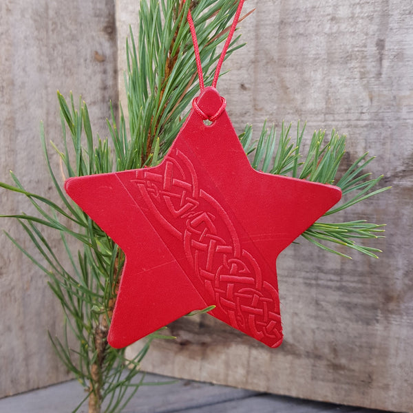 Red leather christmas tree star decoration with celtic knot design