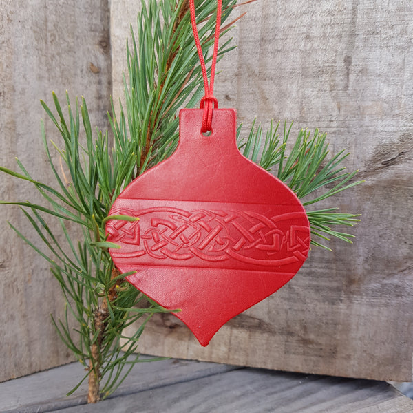 Red leather christmas tree decoration in bauble shape with celtic knot design