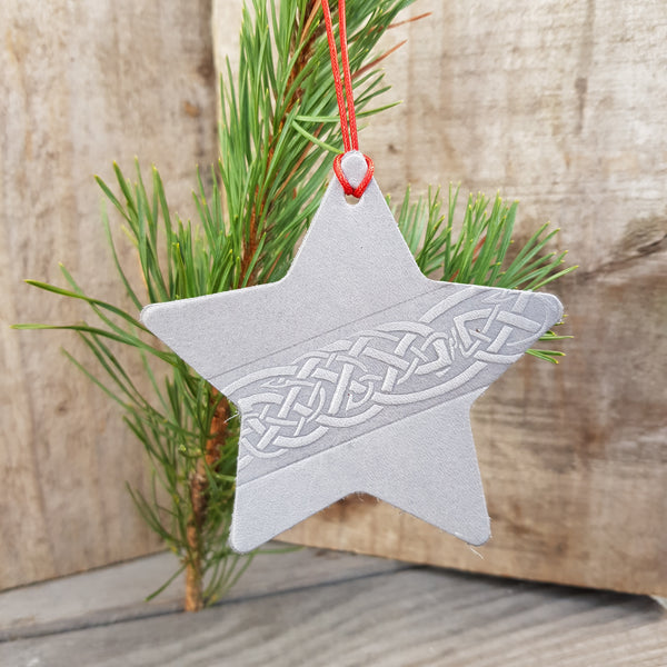 Silver grey leather star christmas decoration with celtic knot design
