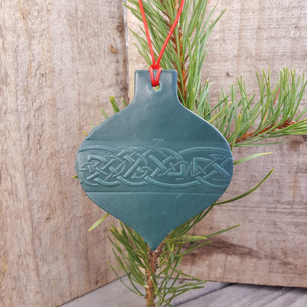 Green leather christmas tree decoration with celtic knot design in bauble shape