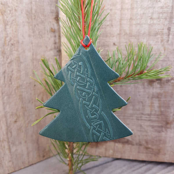 Green leather christmas tree shaped decoration with celtic knot design