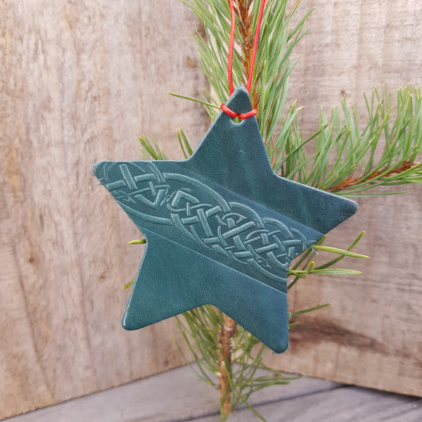 Green leather christmas tree decoration in star shape with celtic knto design
