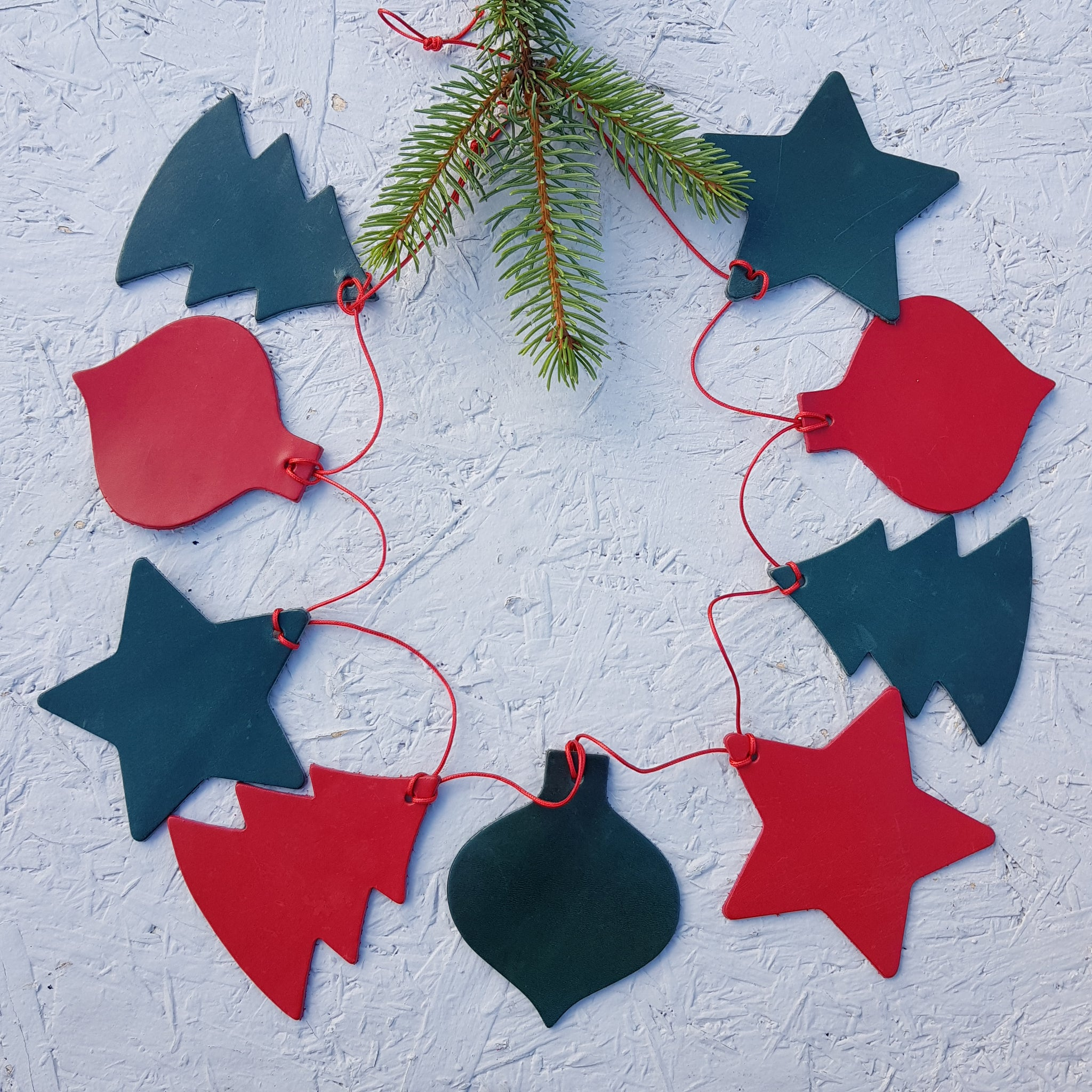 Red and green leather christmas bunting with star tree and bauble shapes