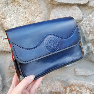 Blue leather handbag with celtic knot