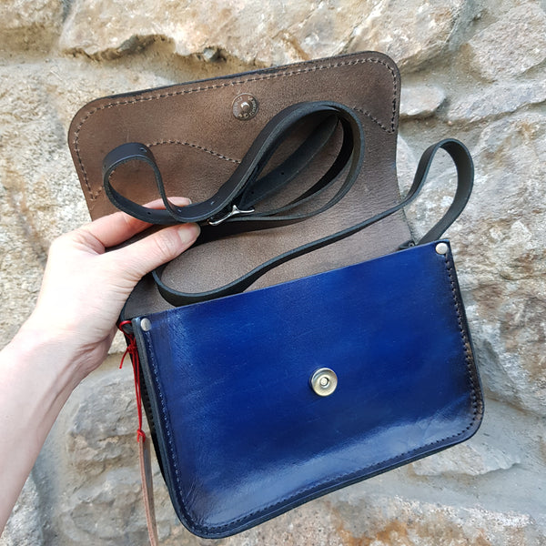 blue leather handbag open