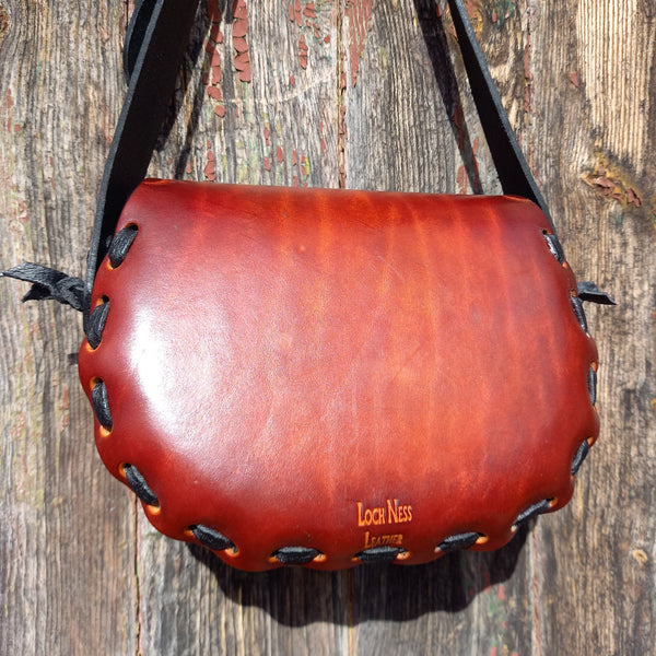 Rear of read handmade leather handbag