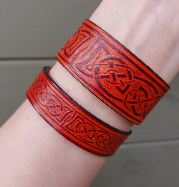 Narrow and wide leather wristband on wrist example