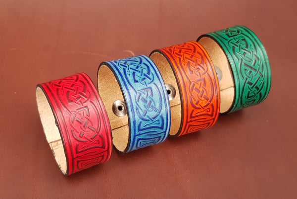 Leather wristband wide in four colours. Red, Blue, Tan and Green