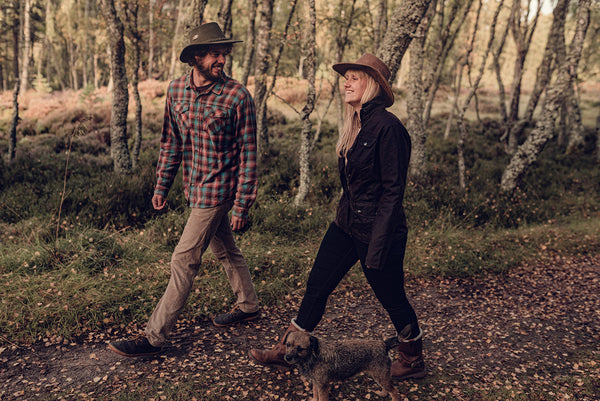 Male and female models walking wearing leather bush hats