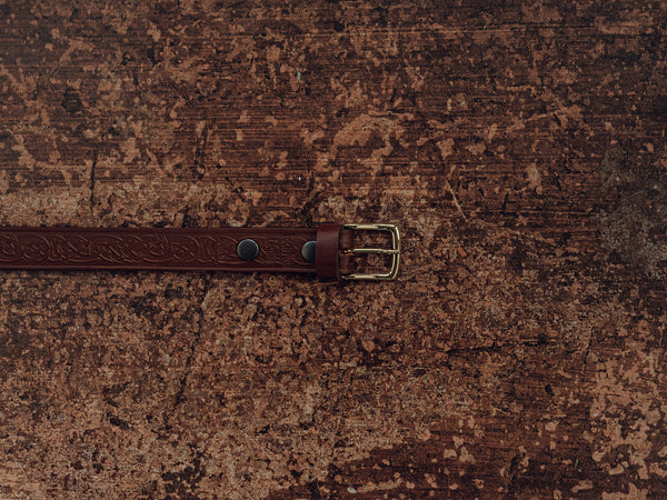 Brown handmade belt with celtic knot design and brass buckle