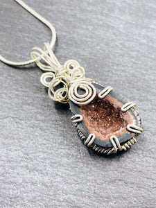 """The Million Years surprise - Red"" Sterling silver and wire wrapped Geode Pendant chain."