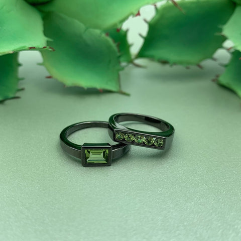 "Black Rhodium Plated Sterling Silver Ring Set with a Rectangle Cut Peridot Gemstone. Size 6.75. Black Rhodium Plated Sterling Silver Ring Set with a Row of Peridot Gemstones. Size 5.25. By: ""Mayson Jewelry"" by Sethi Couture  SETHI1627 - $99 SETHI1629 - $110 Noe Valley Gallery"