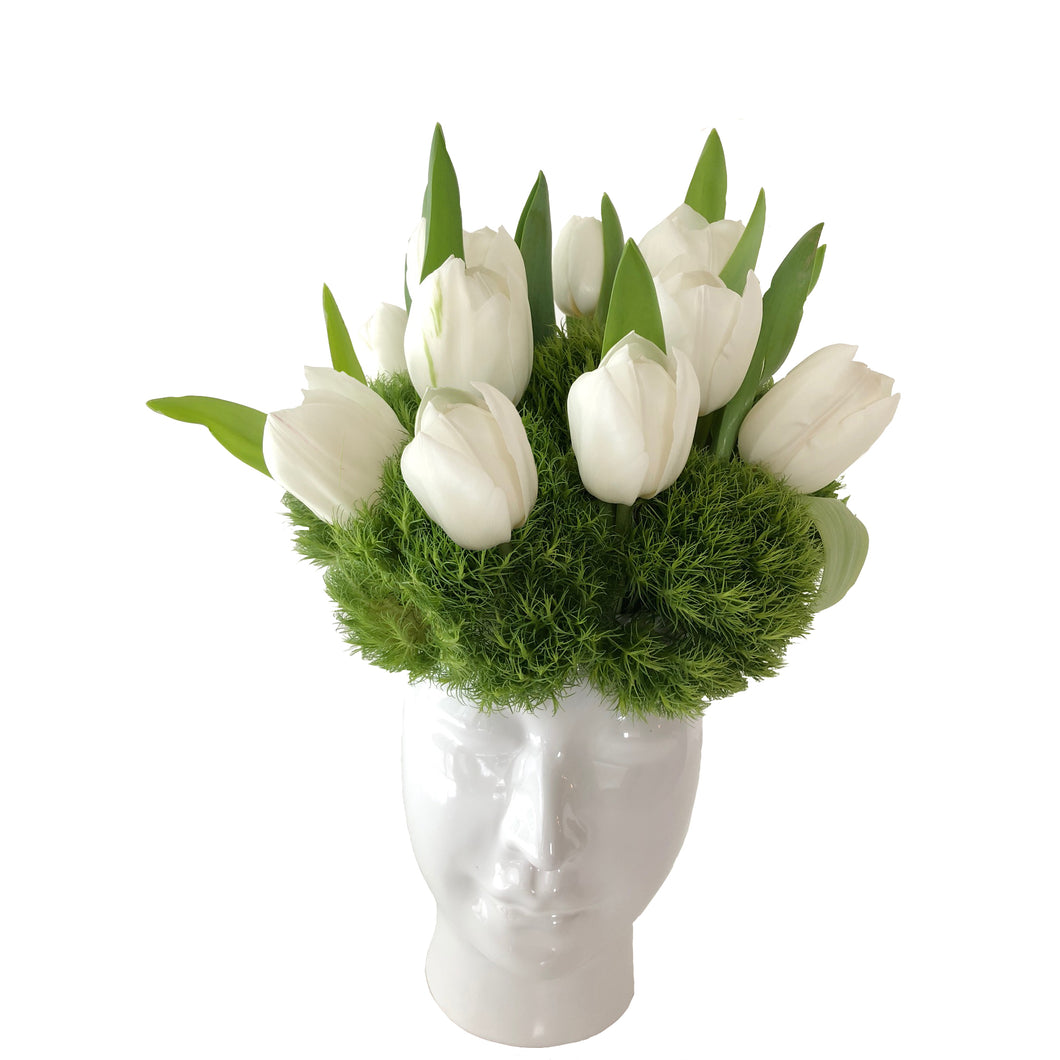 Modern flower arrangement in a Beau vase with white tulips and dianthus for greenery.