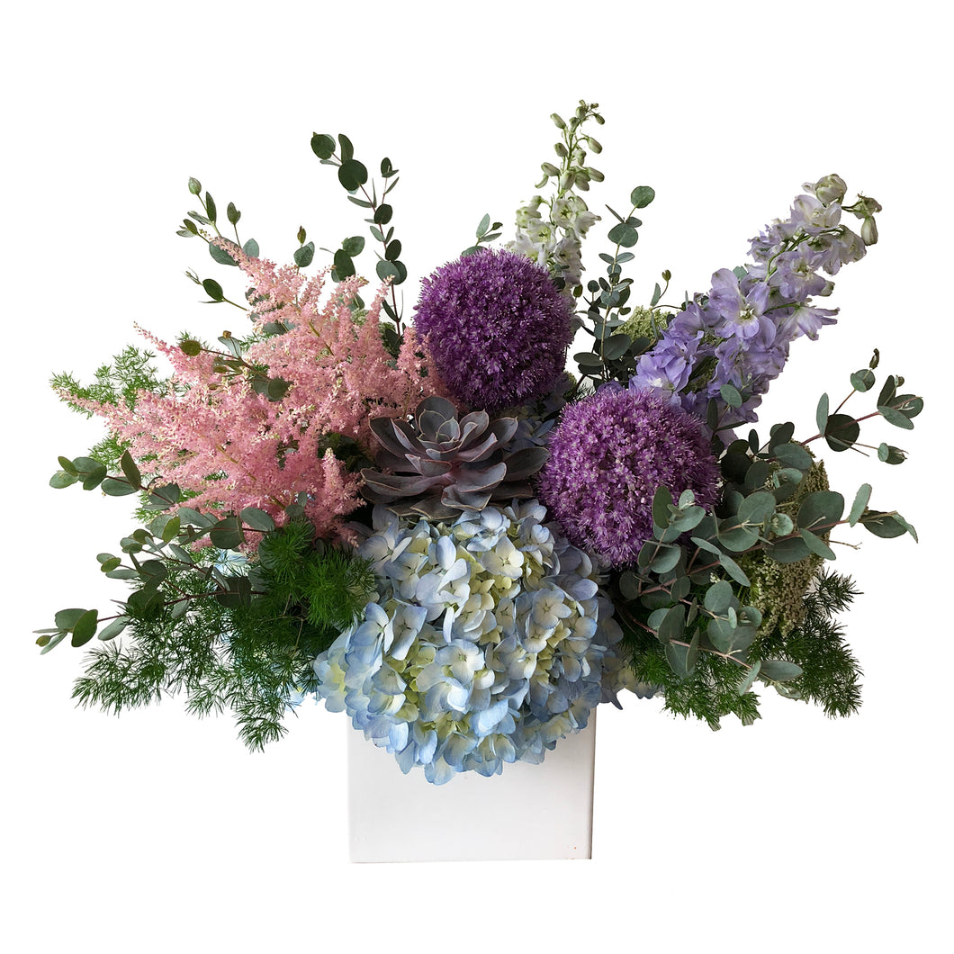 A modern assortment featuring pink astilbe flowers, blue hydrangea, purple allium, violet delphinium arranged in Flower Studio signature style.