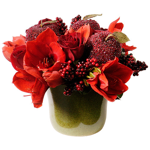Holiday Christmas arrangement monochromatic red featuring amaryllis, red roses, red berries, red sparkling decorative accent arranged in Flower Studio signature style.