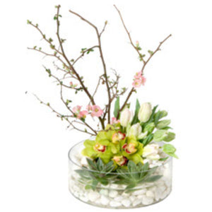 A modern assortment of premium flowers including cymbidium orchids & tulips in Flower Studio's signature style.