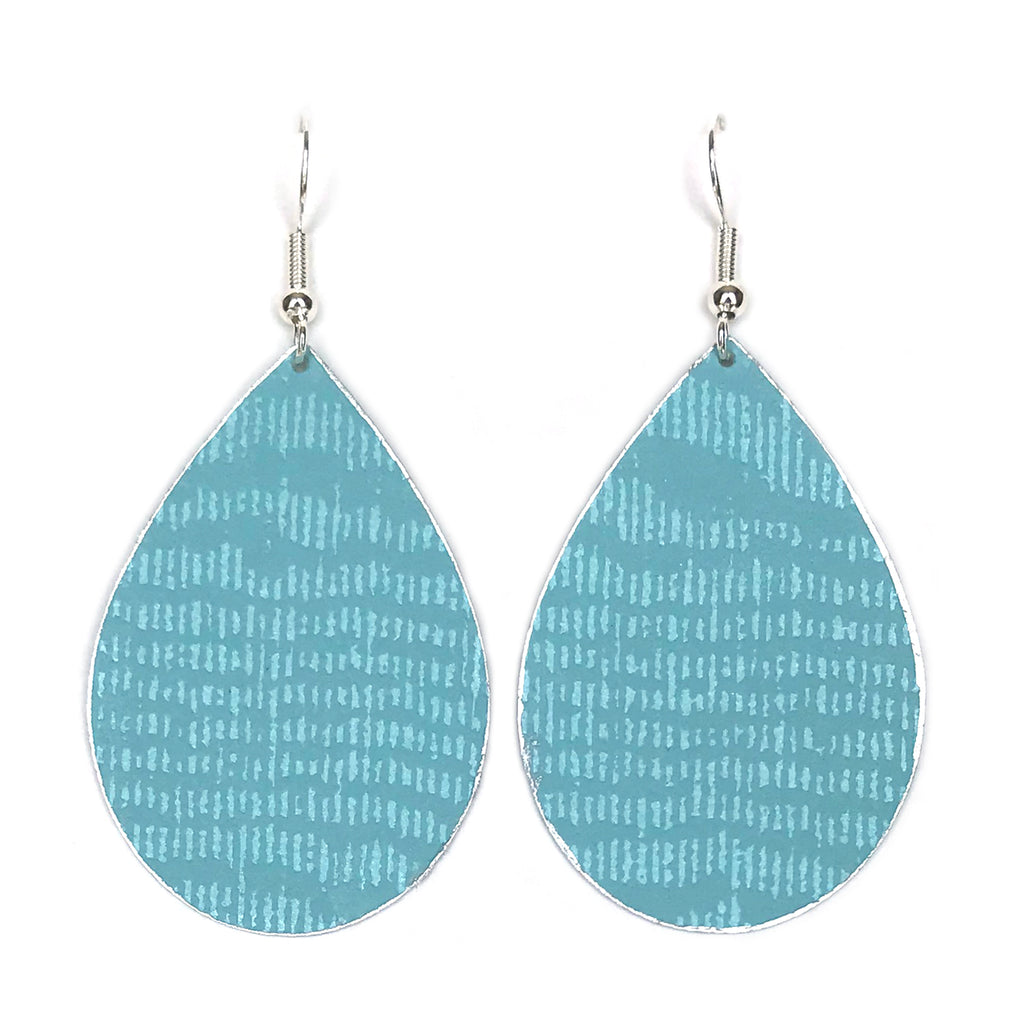 Gracie Nicole Handmade Jewelry. Inspired by daydreams of gazing at the horizon of a tropical sea, the classic teardrop earring is reimagined in a fresh aqua wallpaper with a moire texture in a matte-on-sheen finish that emulates watered silk.