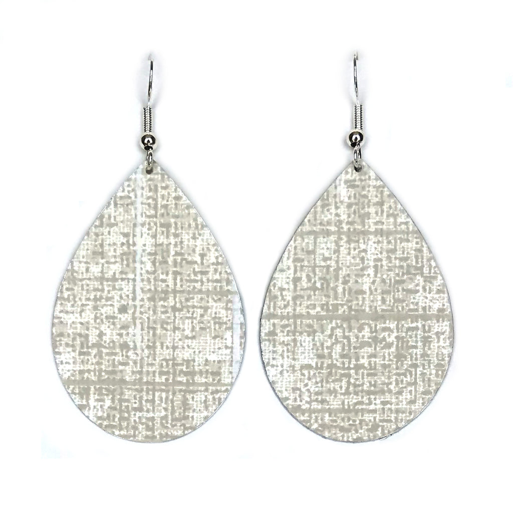 Gracie Nicole Handmade Jewelry. If you want a pretty white and grey neutral, you'll love the earrings made from this elegant wallpaper by York. It's a subtle, pearly color with flecks and lines of pale grey and white. It's a very sophisticated pattern in a classic teardrop shape.