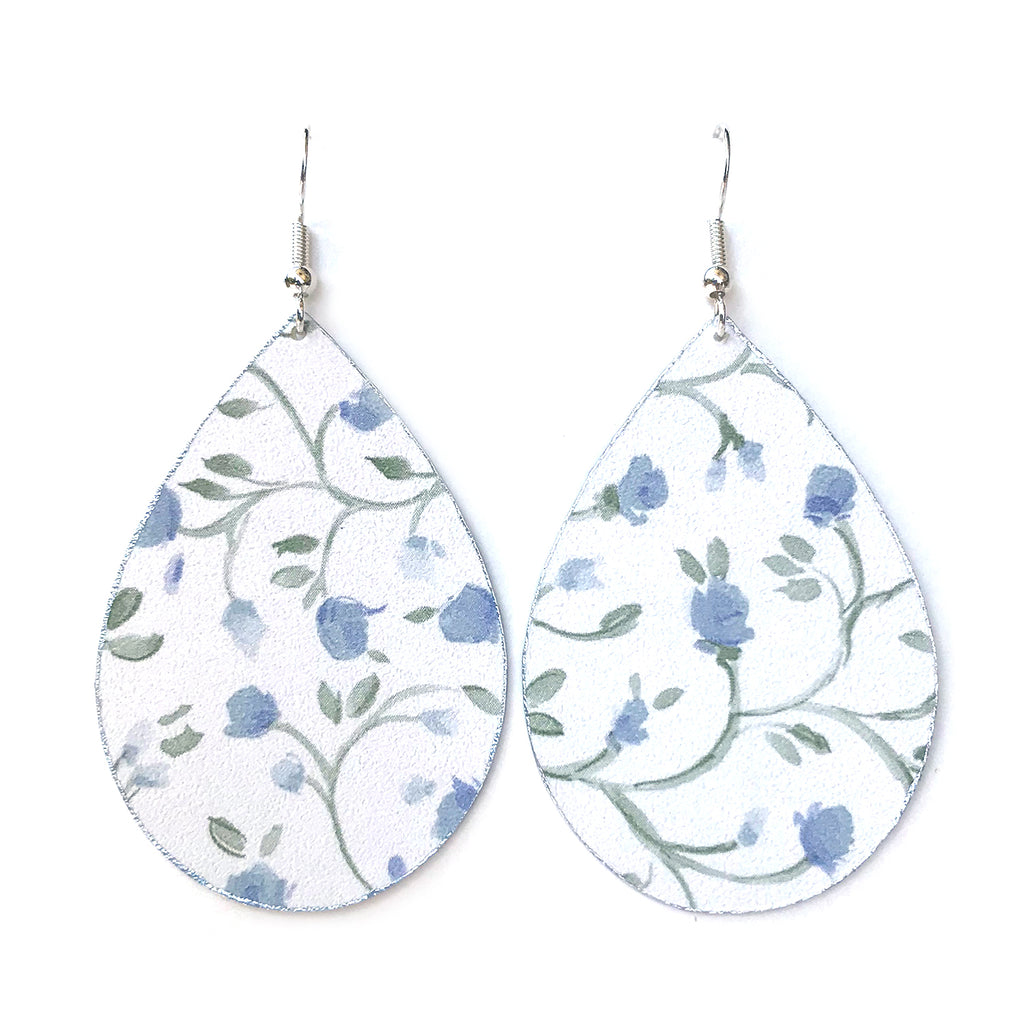 Gracie Nicole Handmade Jewelry These charming earrings are so feminine, and the sweet, and the blue floral print is perfect for summer! The wide teardrop shape makes these a great wardrobe staple, and the cheerful print brings a pretty accent to your outfit.