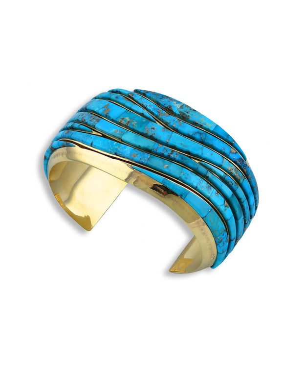 A picture of a turquoise cuff made by Earl Plummer Santa Fe Native American Jewelry.