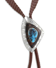 A close up shot of the bolo tie made by Edison Cummings Santa Fe Native American Jewelry