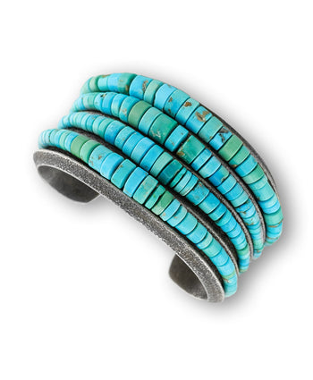 A turquoise strand cuff made by Olin Tsingine Santa Fe Native American Jewelry