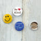 "Our three pin ""kindness button set"" is a bright and happy way to remind everyone around you that kindness matters."