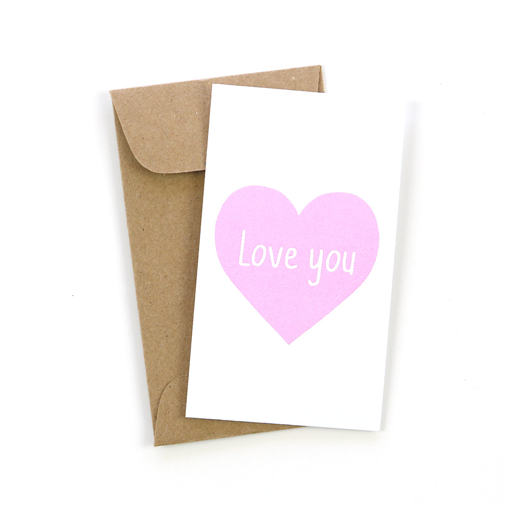 "Our mini cards are perfect to have on hand. This pink heart ""love you"" card makes a great lunchbox note or tucked in luggage for your favorite traveler. Stock up today!"
