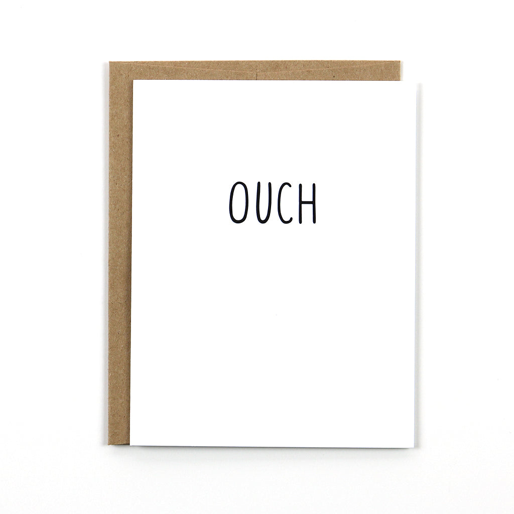 "Our simple black and white ""ouch"" card is perfect when you need to shower a loved one or friend with sympathy."