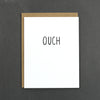 """Ouch"". This minimalist card is a perfect card to keep in your collection. It is great for any bumps, bruises, broken bones, and bruised egos you might encounter."