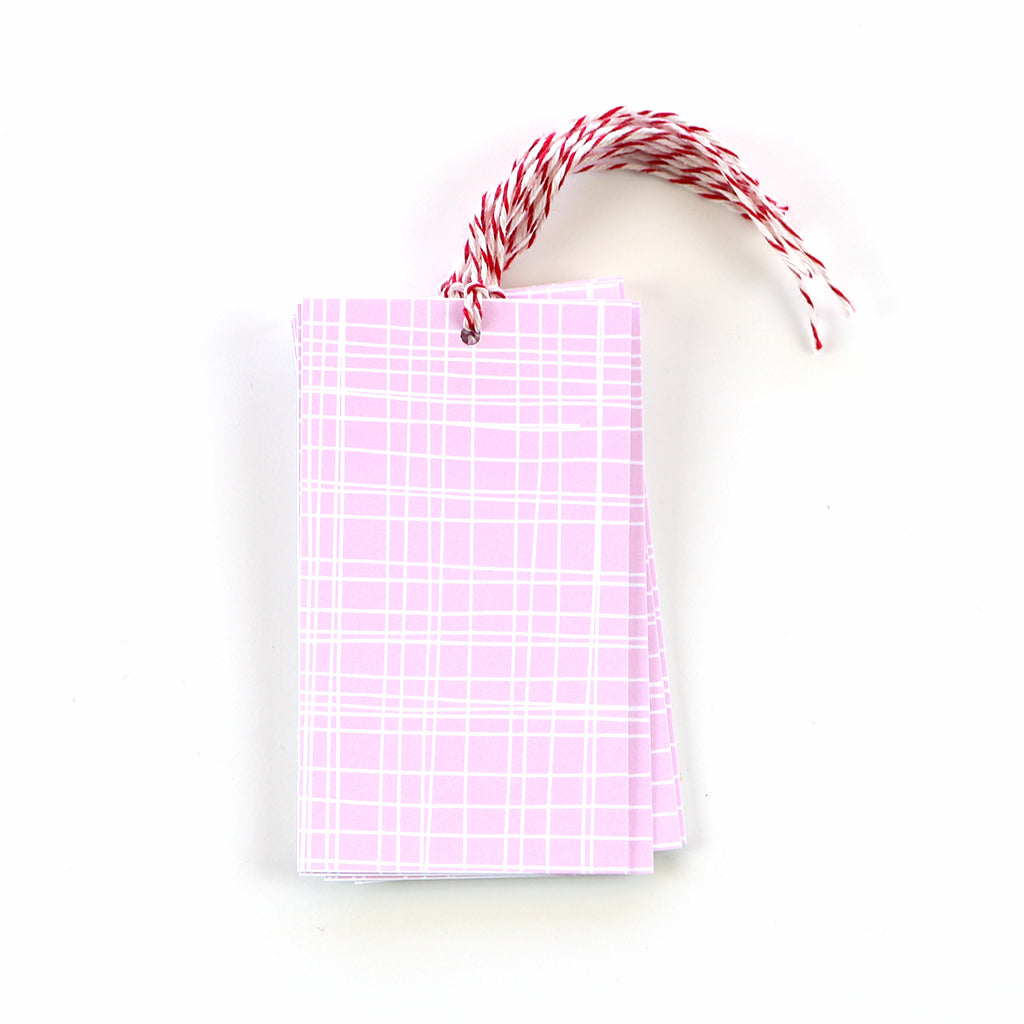 These light pink gift tags feature a white grid print and are the perfect addition to absolutely any package.