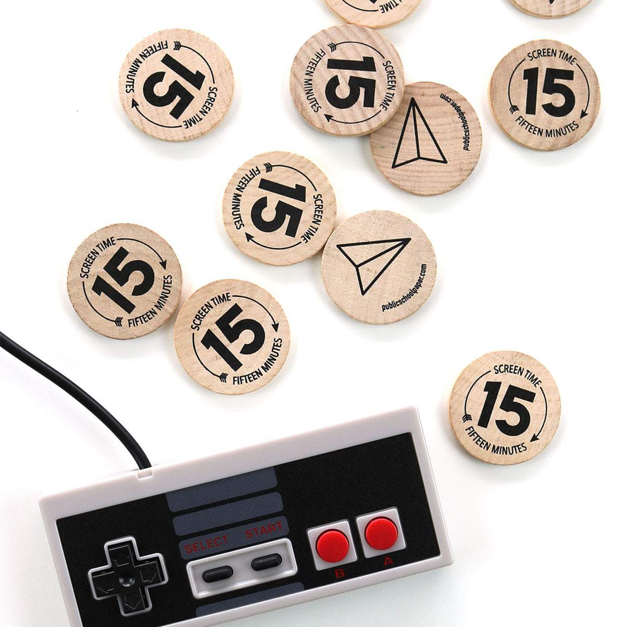 "Our wooden ""screen time"" tokens are a fun tangible way for kids to realize how much time they are spending on screens. There are 12 wooden token in a pack. Each wooden coin is screen printed and built to last."
