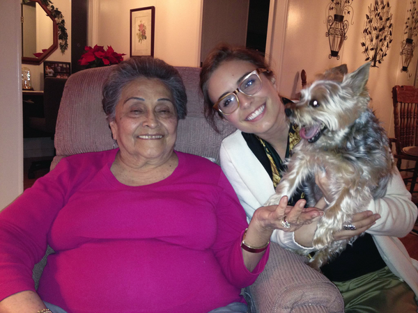 a grandma and her granddaughter and a small dog