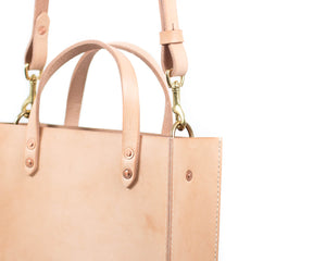Small Natural Vegtan Leather Tote with Top Handle and Adjustable Shoulder Strap Detail