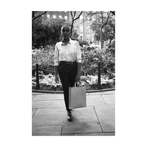 Black and White View of Person In Park Walking With Tote