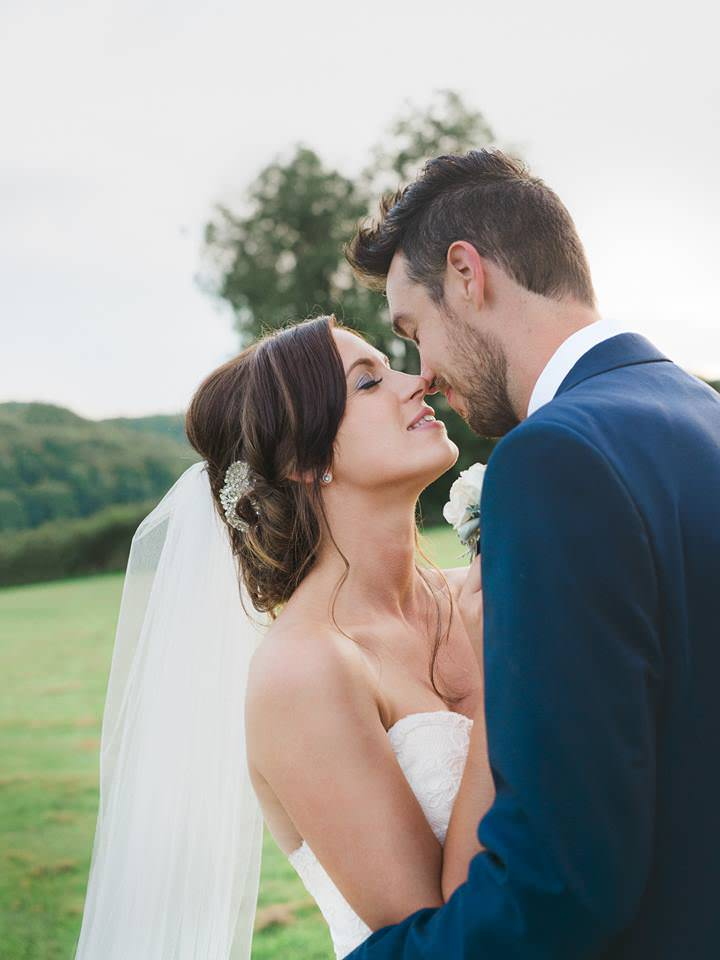 romantic outdoor wedding with wedding veil over bun and beaded hair comb