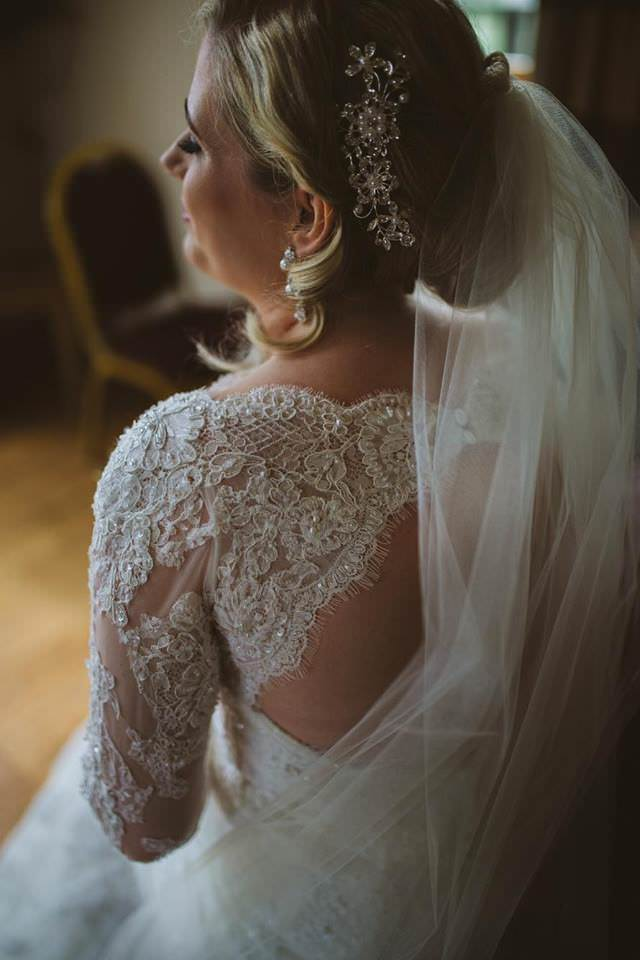 crystal beaded hair piece in updo with long white veil