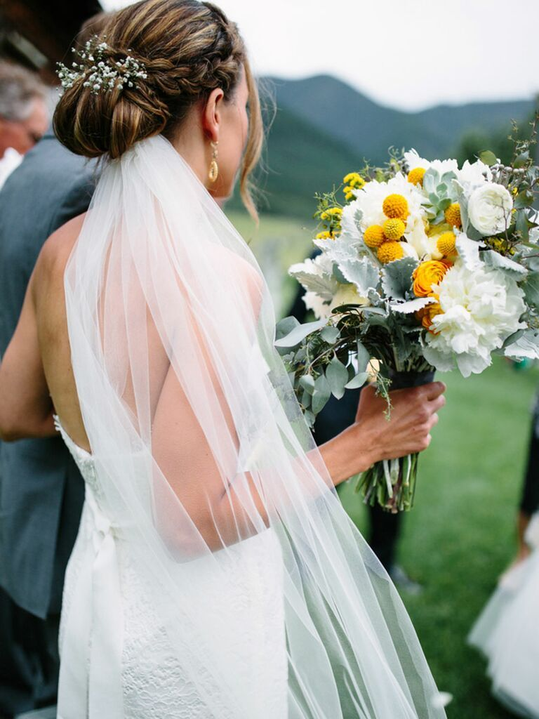 boho wedding inspiration with bride wearing simple veil under her chignon with braids