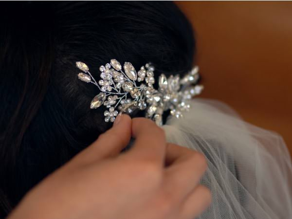 rhinestone and pearl beaded hair comb layered with veil