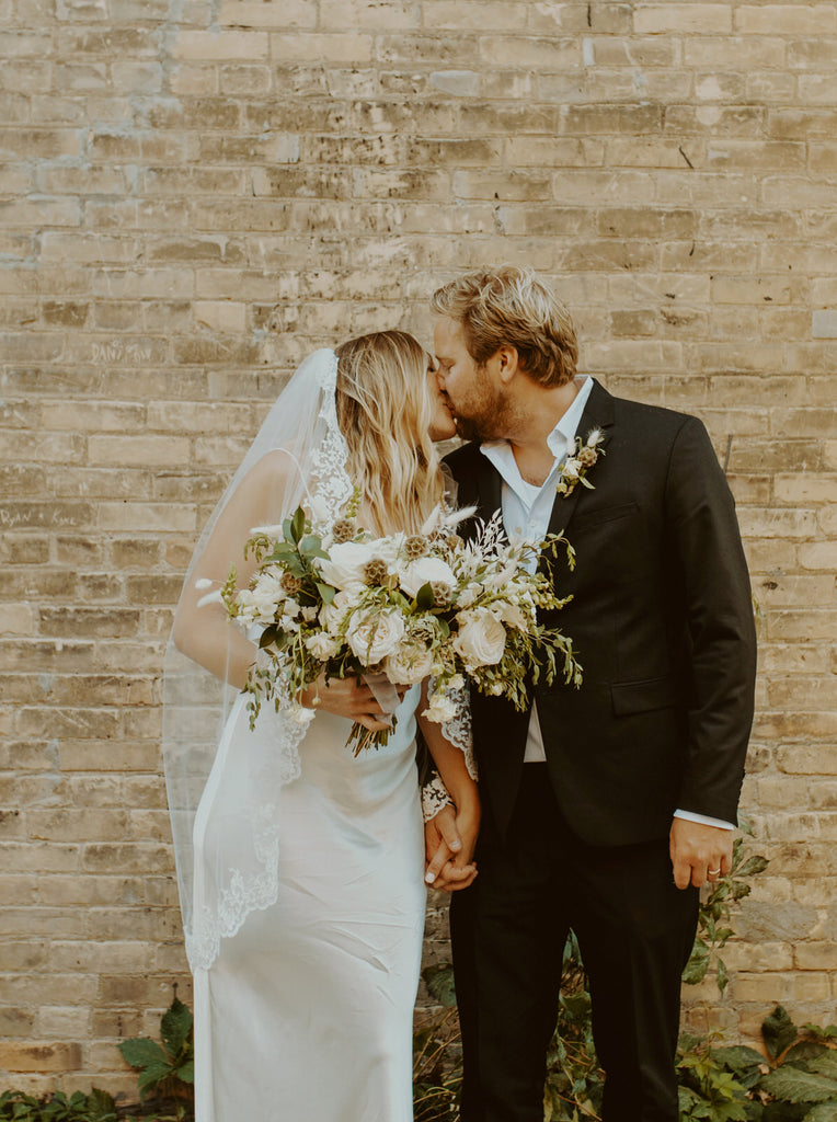 elopement wedding with bride in simple sheath and short lace veil