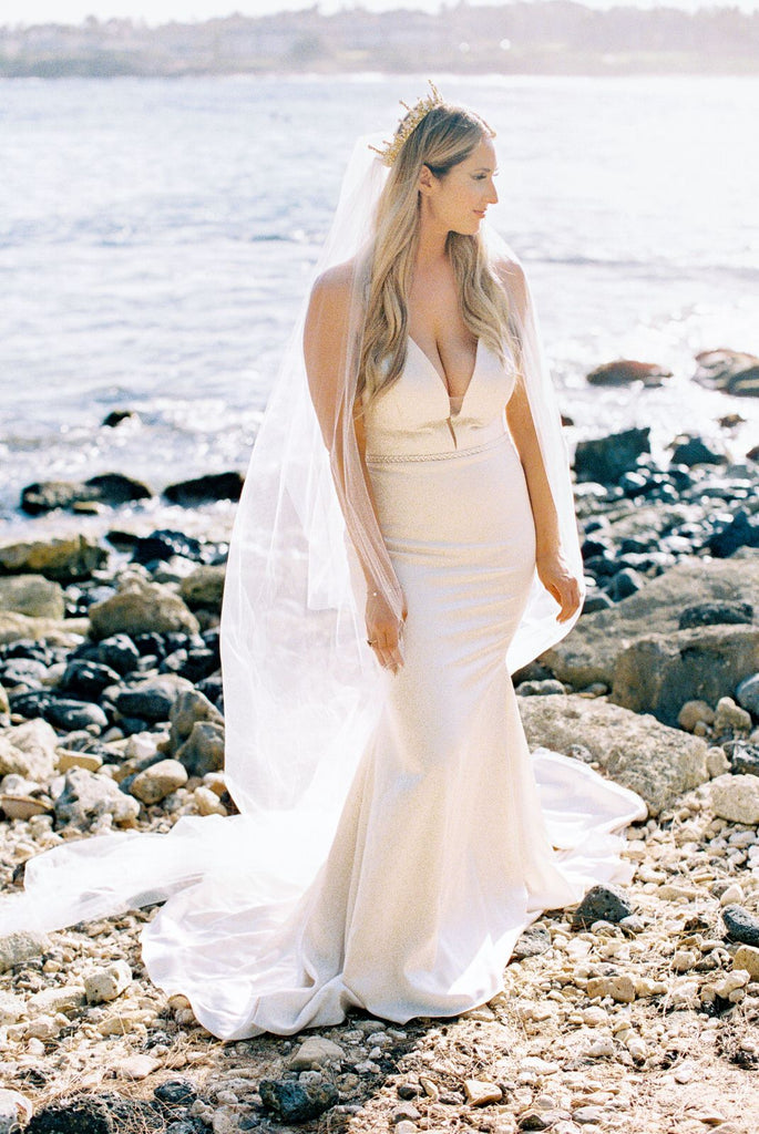 beach minimalist wedding with bride in cathedral veil and gold crown
