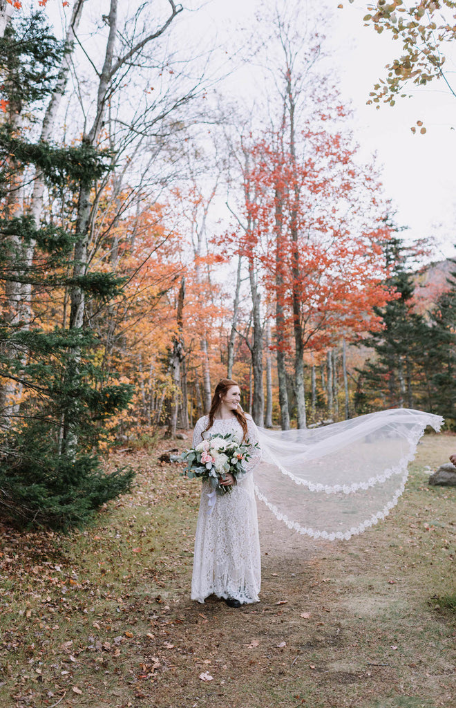 autumn wedding in the woods with whimsical venice lace cathedral veil