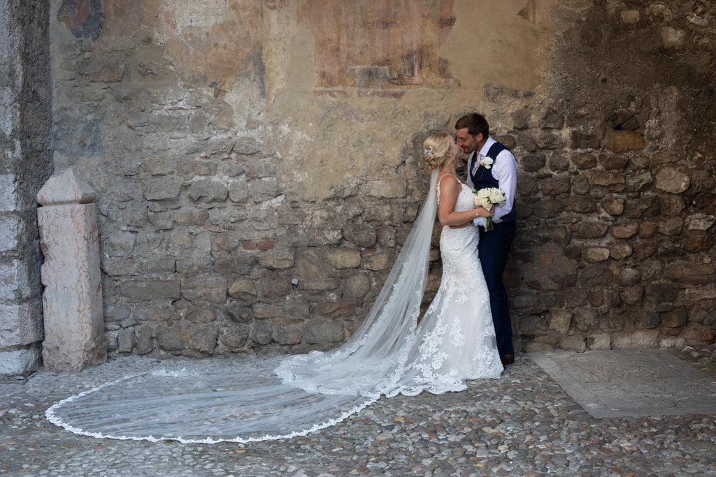 all lace scalloped gown with bride wearing long royal length wedding veil